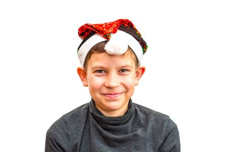 boy in Santa hat on white isolated background 版權商用圖片