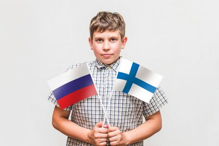 teen boy holds the flags of the Standard-Bild