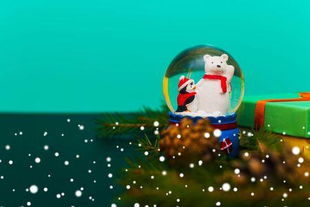 Snow globe and snowflakes. Christmas paraphernalia Stock Photo