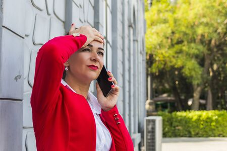 business woman talking on the phone on the street. solving problems on the phone.