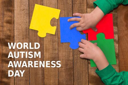 children's hands collect puzzles. the concept of autism Stok Fotoğraf