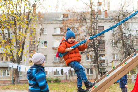 October 2019, Russia, Bryansk. Boys playing in the Playground Editöryel
