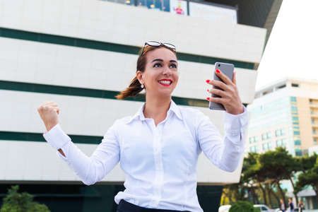 happy successful business woman. Business lady with a phone. Stok Fotoğraf
