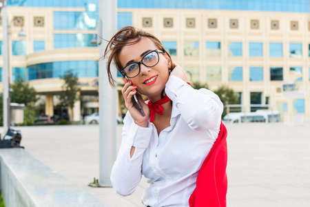 successful business woman talking to phone in superhero cape