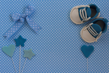 Baby boy blue card. Newborn background. Baby shower invitation.Baby announcement. Fondant baby accesories. Flat lay
