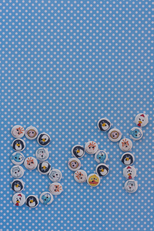 Boy sign. Baby shower idea. Blue polka dots background. Baby announcement. Kids buttons