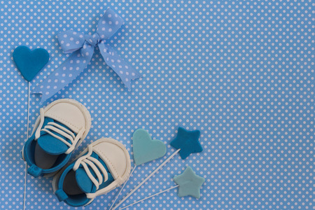 Baby boy blue card. Newborn background. Baby shower invitation. Fondant baby accesories.