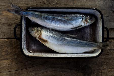 Two raw fish,prepared to bake. Top view. Healthy lifestyle. Mediterranean diet. Fish recipe ideas