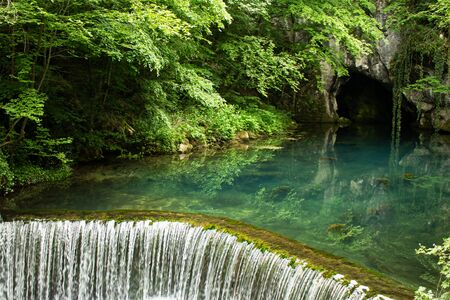 Monument of nature, spring of  river Krupaja or Krupajsko vrelo with underwater cave. Beautiful oasis, tourist attraction and recommended peaceful place to visit in Eastern Serbia. Banque d'images