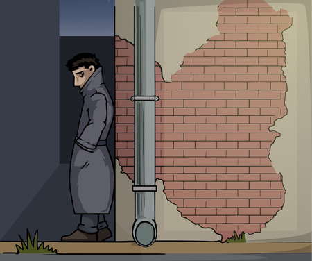 smuggling: Shady character hiding in a shadows next to a brick wall