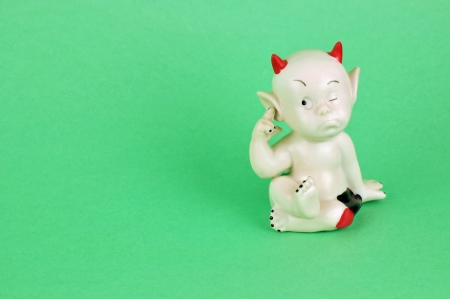 wait ceramic imp isolated on green  Clipping path included