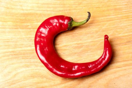 red chili pepper: Red chili pepper on wooden table Stock Photo