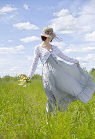 blowed: Young beautiful woman in dress blowed by the wind Stock Photo