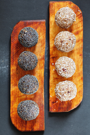 carob: Assorted raw vegan sweet candy balls with carob, coconut and poppy seeds