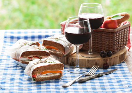 picknick: Healthy picnic for two, for a summer vacation with healthy sandwiches, fruits and glasses of refreshing wine