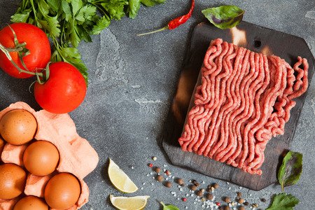 Raw Ground beef meat with ingredients and seasoning for burger Stock Photo