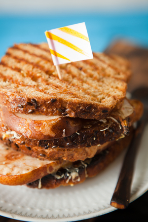 grill: Whole grain grilled sandwich with peanut butter, melted cheese and pears, selective focus