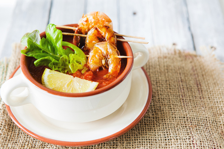 Gaspacho, andalusian tomato soup with grilled shrimps Stock Photo