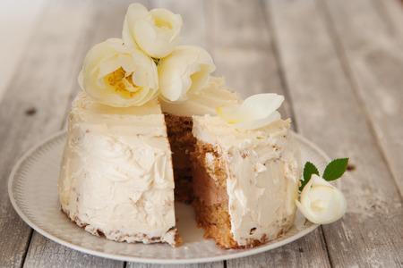 Hazelnut meringue cake decorated with flowers