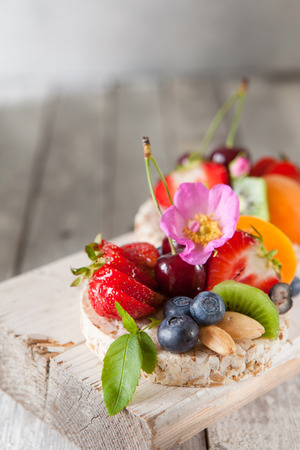 processed grains: Healthy multigrain rice cakes with berries, fruit and almond