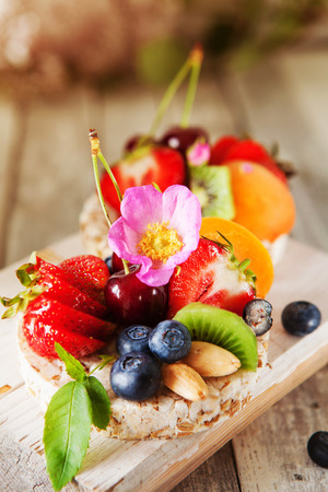 Healthy multigrain rice cakes with berries, fruit and almond