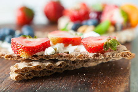 Healthy rie cakes with berries, close up Stock Photo