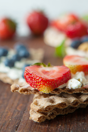processed grains: Healthy rie cakes with berries, close up Stock Photo