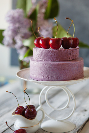 Blueberry mousse cake with fresh cherry