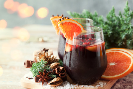 Glasses of punch for winter and Christmas with fruits and wine, mulled wine