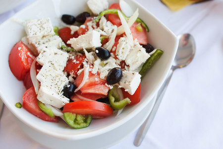 cucumbers: Greek salad with fresh vegetables, feta cheese and black olives in restaurant
