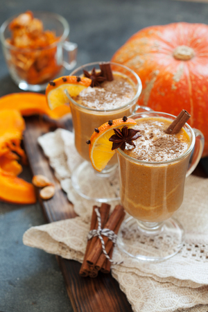 Pumpkin spice latte, hot coffee drink with pumpkin and cinnamon close up