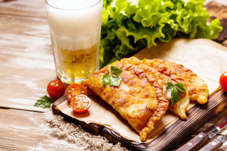 Cheburek, fried pie with meat and onion, traditional turkish and mongolian dish, copy space
