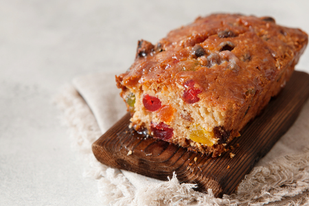 Traditional fruit cake pudding with dried fruits on wooden board copy space Stock Photo