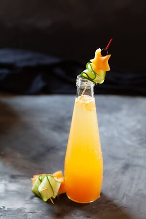 Melon juice, lemonade garnished with cucucmber slice. Concept of fresh summer drink