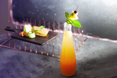 Melon juice, lemonade garnished with cucucmber slice. Concept of fresh summer drink with water drops