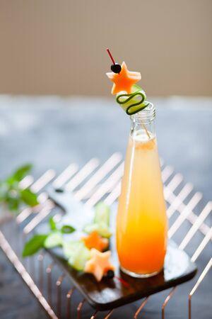 Melon juice, lemonade garnished with cucucmber slice. Concept of fresh summer drink Stockfoto
