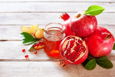 Rosh Hashana concept, jewish New Year holiday with traditional symbols: apples, pomegranate and honey