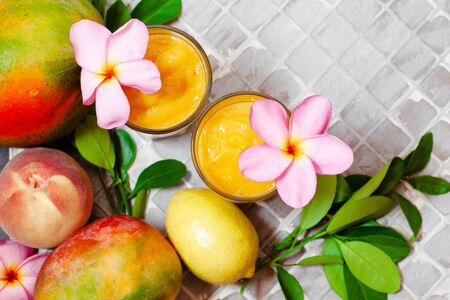 Fresh tropical fruit smoothie mango juice with leaves and fruits top view Stockfoto - 129161718