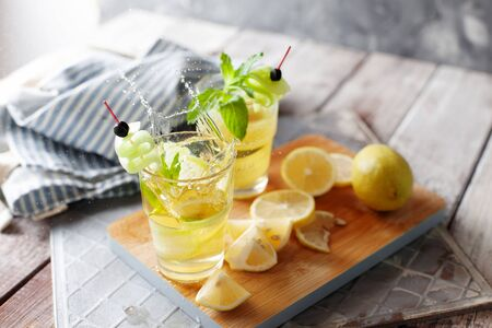 Splash of cucumber and lemon detox water. Homemade detox drink Stockfoto