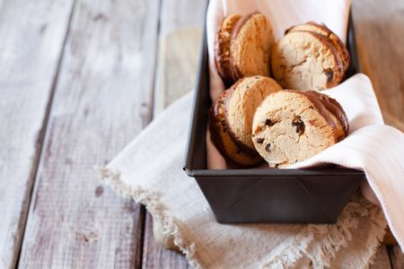 Traditional Chocolate cookies on wooden table copy space