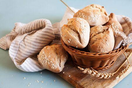 Ciriola romana sourdough buns with oat flakes, traditional Italian bread
