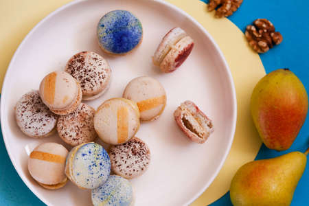 Top view of assorted macarons on a plate copy space, party concept