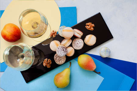 Top view of box with macarons and wine glasses copy space, party concept