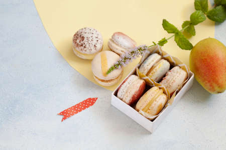 Top view of box with macarons copy space, party concept
