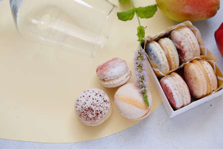 Top view of box with macarons and wine glass copy space, party concept