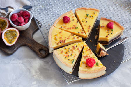 Pie with chocolate cream and passion fruit, decorated with raspberry. Summer dessert tart