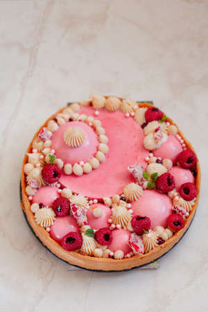 Raspberry Tart with berry mousse and white chocolate cremo copy space