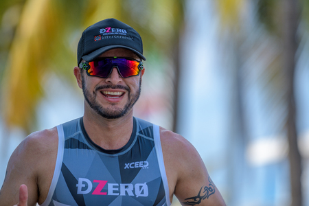 Smiling runner at ironman