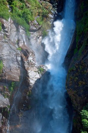 crampon: Beautiful falls on a way, traveling around Annapurna. Stock Photo