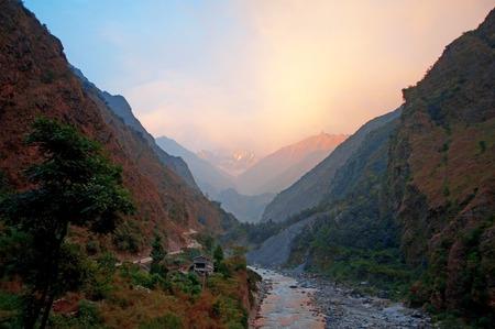 crampon: Beautiful river on a way, traveling around Annapurna. Stock Photo